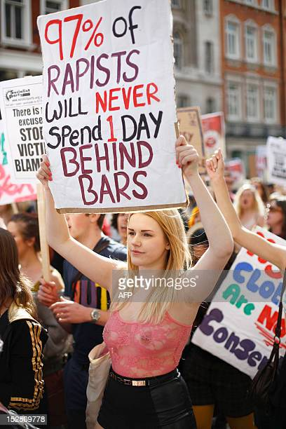 Women hold banners as they take part in a 'slut walk' in London on September 22 2012 to protest against the police and courts' denial of justice for...