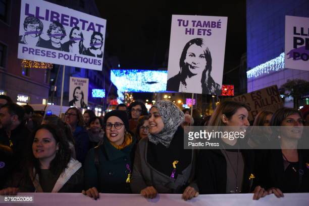 Women hold banners demanding freedom for the Catalan political prisoners as they take part in a protest in Barcelona during the International Day for...