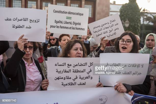 Women hold banners during a protest on 'violence against women' regarding the International Women's Day in front of Parliament Building in Rabat...