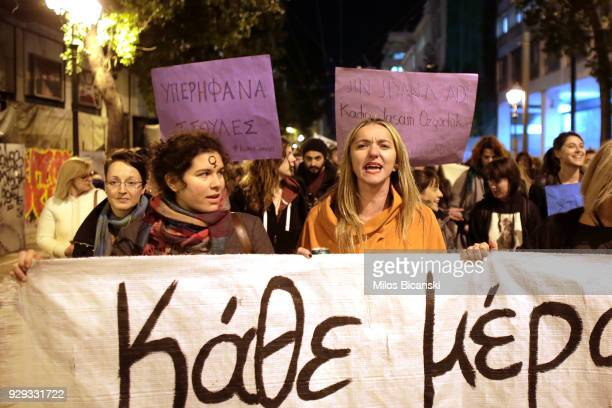 Women hold banners during a rally for International Women's Day on March 8 2018 in Athens Greece Women around the world attended events rallies talks...