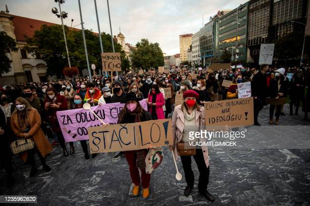 Women hold banners saying Enough during a protest against a new legislation relating abortions in Bratislava, Slovakia on October 18, 2021.