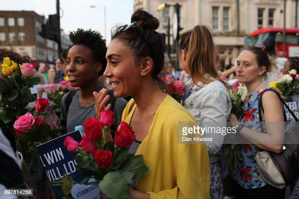 Women hold flowers as they attend a vigil outside Finsbury Park Mosque on June 19 2017 in London England Worshippers were struck by a hired van as...