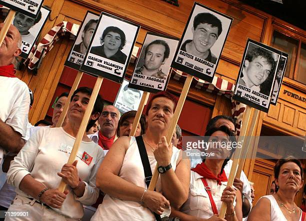 Women hold photographs of family members and Basque separatist prisoners during a demonstration demanding their release at the San Fermin fiesta on...
