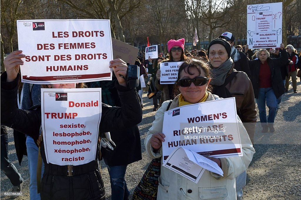 Women hold placard in support of the Women's March taking place in Washington and many other cities on January 21, 2017 during a rally in Bordeaux, Southwestern France, one day after the inauguration of the US President. Protest rallies were held in over 30 countries around the world in solidarity with the Washington Women's March in defense of press freedom, women's and human rights following the official inauguration of Donald J Trump as the 45th President of the United States of America. / AFP / MEHDI