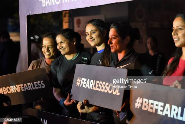 Women hold placards as they participate in The Fearless Run a midnight run of 5 kilometers which was organised in the presence of Delhi Police...