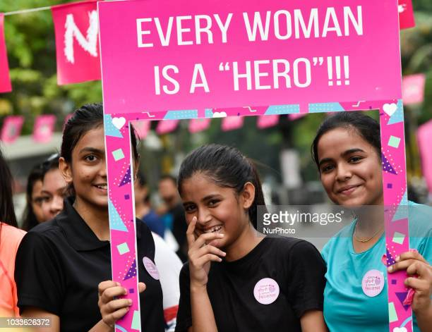 Women hold placards as they participate in zumba aerobics and salsa for awareness session to promote healthy lifestyle for women Pinkathon in...