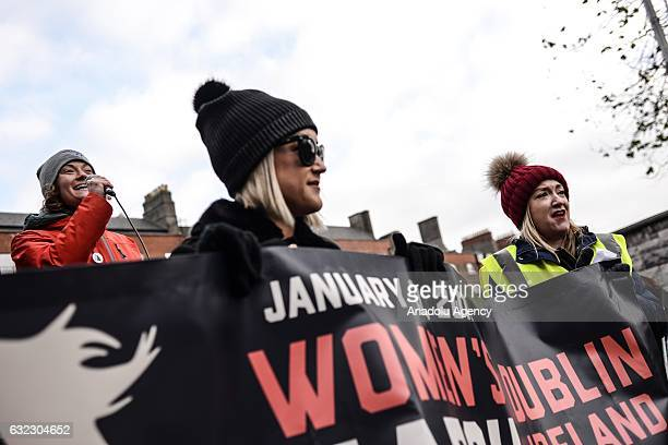 Women hold placards during a protest held in solidarity with the Washington DC Women's March in Dublin Ireland on January 21 2017