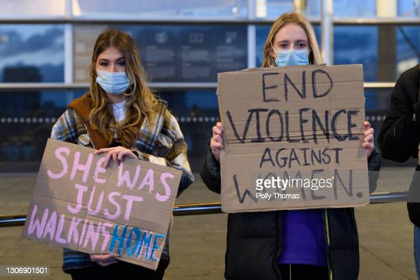 Women hold placards during a vigil held in memory of Sarah Everard on March 13, 2021 in Cardiff, United Kingdom. Vigils are being held across the...