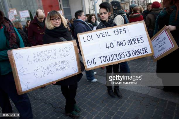 Women hold placards reading 'Let them choose' and 'Veil Law 1975 40 years after IVG still in danger' as they demonstrate to defend abortion rights in...