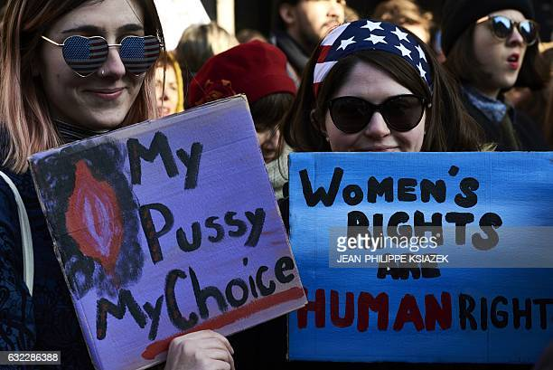 TOPSHOT Women hold placards reading 'My pussy my choice' and 'Women's rights are human right' during a rally in solidarity with the Women's March...
