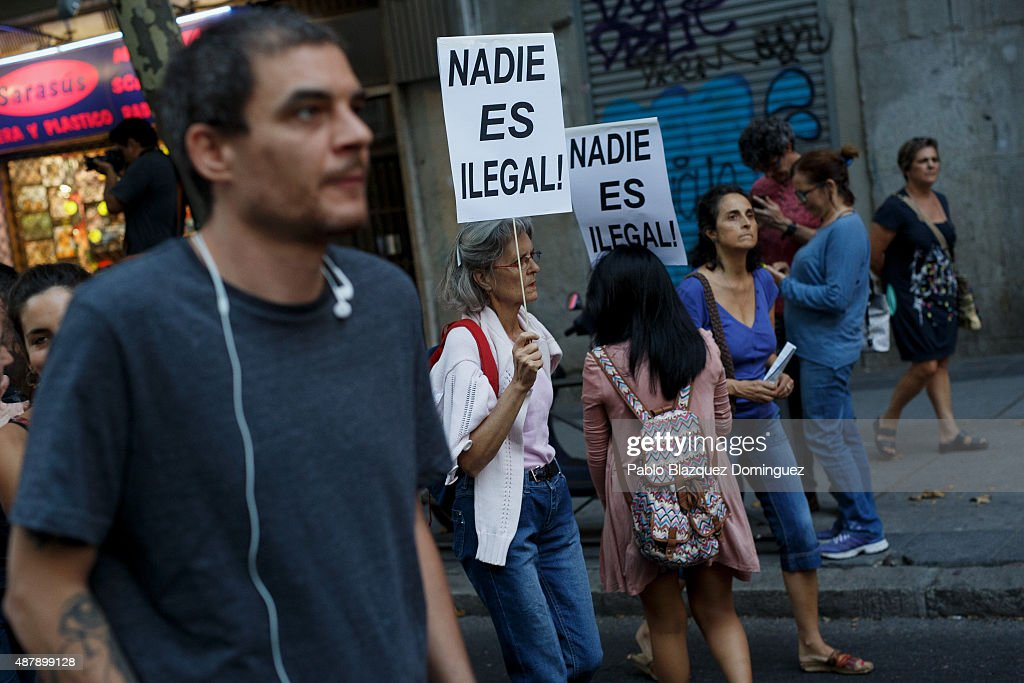 Women hold placards reading 'Nobody is illegal!' during demonstration to show solidarity and support for refugees on September 12, 2015 in Madrid, Spain. Several cities across Spain have called for demonstrations under the slogan 'Welcome refugees. For a more responsible European policy'. Europe is facing the region's largest crisis of migrants and refugees since World War II. Spain would have to take nearly 15,000 refugees under a new European Union plan to relocate 120,000 refugees. Many Spanish cities and citizens took the lead on offering their support to refugees.