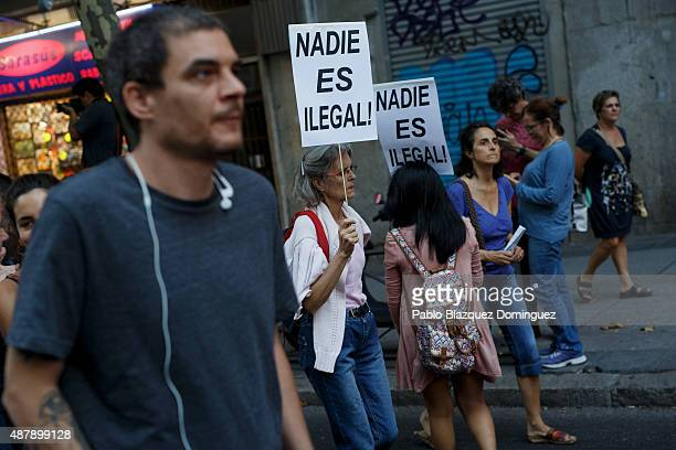 Women hold placards reading 'Nobody is illegal' during demonstration to show solidarity and support for refugees on September 12 2015 in Madrid Spain...