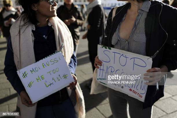 Women hold placards reading 'Stop Harassement' and '#metoo' as people gather for a rally at the Old Port of Marseille southern France on October 29...