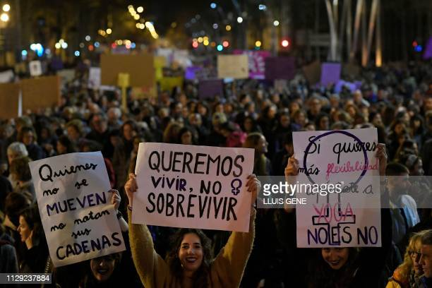 Women hold placards reading 'We want to live not to survive' 'Those who do not move do not notice their chains' and 'If you want more flexibility go...