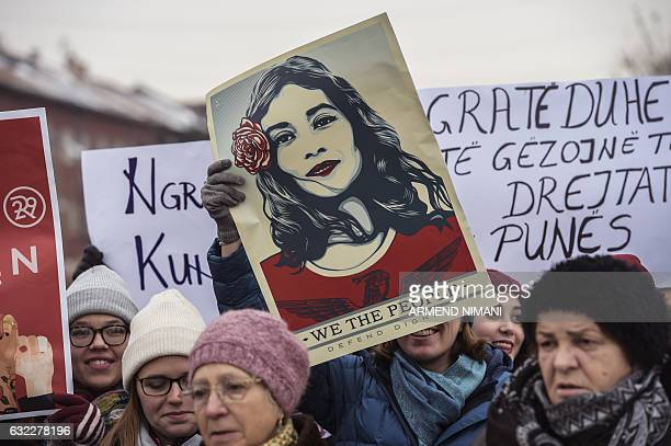 Women hold posters as they take part in a march for women's rights and freedom in solidarity with the march organised in Washington, on January 21,...