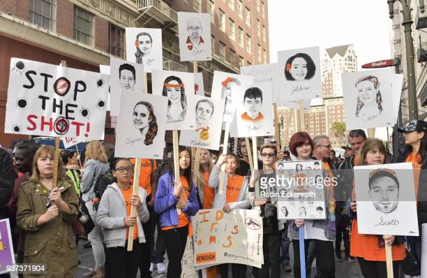Women hold signs as they attend the March For Our Lives LA on March 24 2018 in Los Angeles California More than 800 'March for Our Lives' events are...