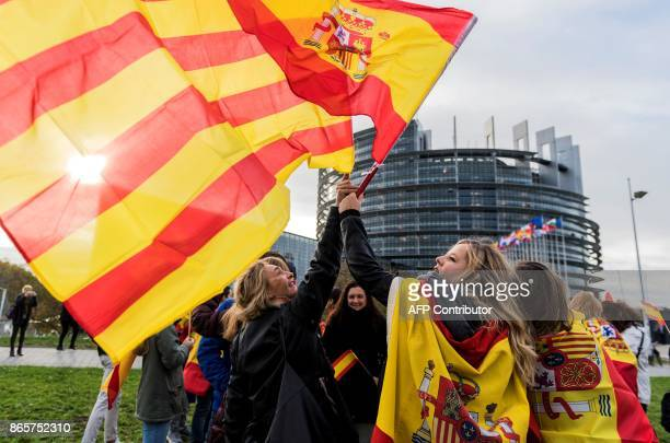 Women hold Spanish and Catalan flags during a demonstration against Catalonia's independence in front of the European Parliament in Strasbourg...