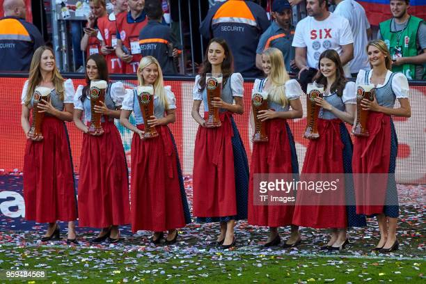 Women hold the wheat beer showers after the Bundesliga match between FC Bayern Muenchen and VfB Stuttgart at Allianz Arena on May 12 2018 in Munich...