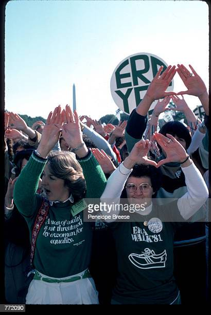 Women hold their hands in the air supporting the ERA at the Call to the Nation's Conscience ERA rally on the steps of the Lincoln Memorial October 12...