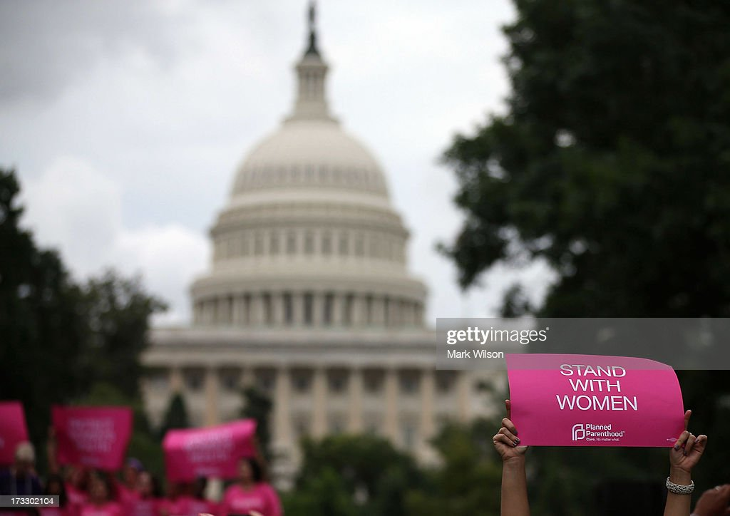 Women hold up signs during a women's pro-choice rally on Capitol Hill, July 11, 2013 in Washington, DC. The rally was hosted by Planned Parenthood Federation of America to urge Congress against passing any legislation to limit access to safe and legal abortion.