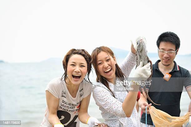 Women holding a fish frolic
