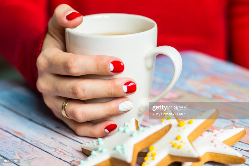 Women holding cup of a tea : Stock Photo