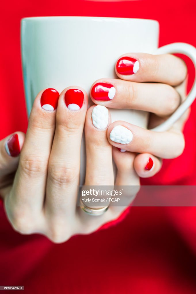 Women holding cup of tea cup : Stock Photo