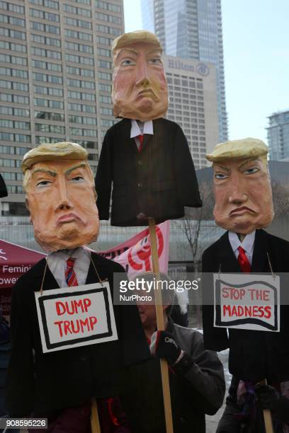 Women holding effigies depicting American President Donald Trump as hundreds take part in the Women's March in downtown Toronto Canada on January 20...