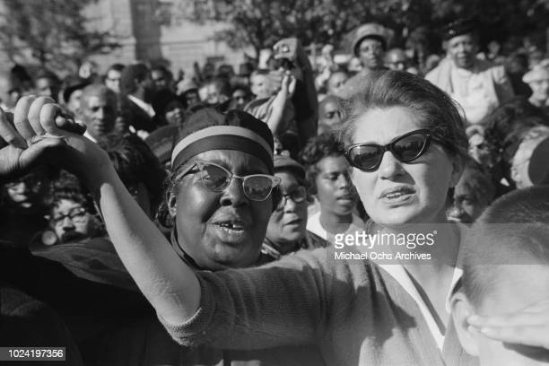 Women holding hands at a civil rights demonstration in Washington DC in the aftermath of the 16th Street Baptist Church bombing in Birmingham Alabama...