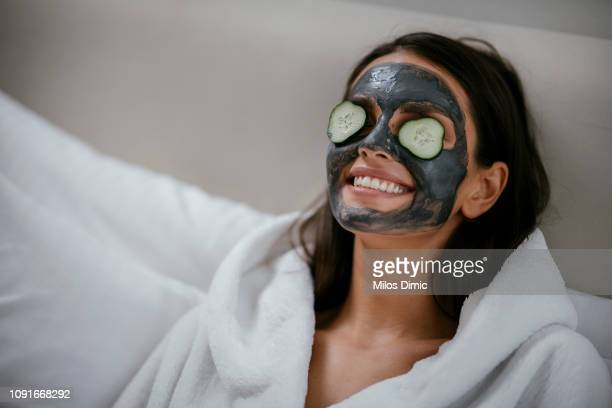women holding slices of cucumber - face masks imagens e fotografias de stock