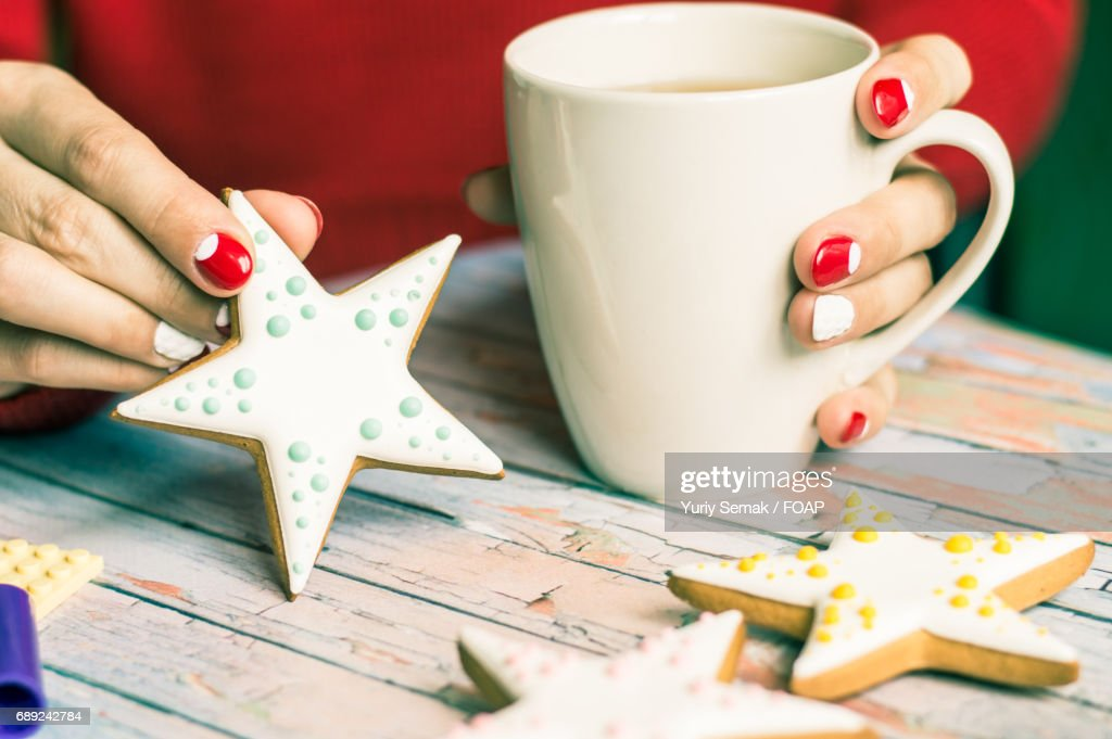 Women holding star shape cookie : Stock Photo