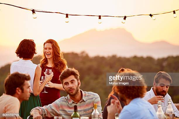 women holding wine glasses at dinner party - public celebratory event fotografías e imágenes de stock