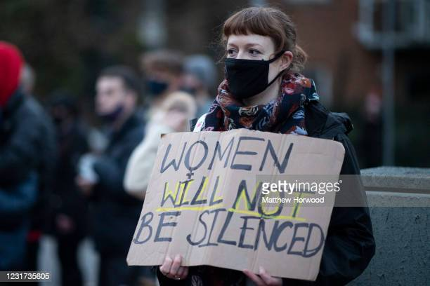 Women holds a sign saying women will not be silenced outside Cardiff Bay police station during a protest on March 15, 2021 in Cardiff, Wales. Labour...