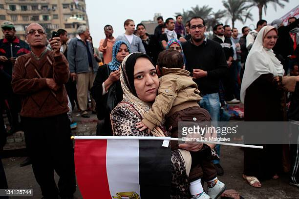 A women holds a young children and an Egyptian flag on Tahrir Square on November 26 2011 in Cairo Egypt Thousands of Egyptians are continuing to...