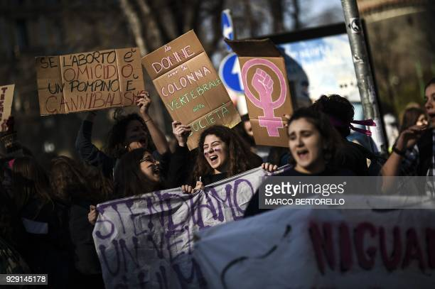 Women holds placards reading If abortion is murder blowjob is cannibalism and Women are the vertebral column of sociaety during the Women March...