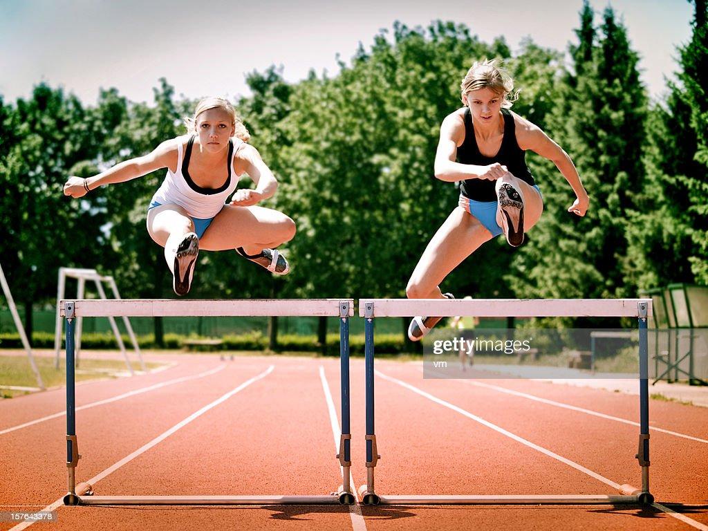 Women Hurdling : Stock Photo