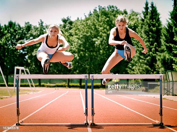 women hurdling - hurdling stock photos and pictures