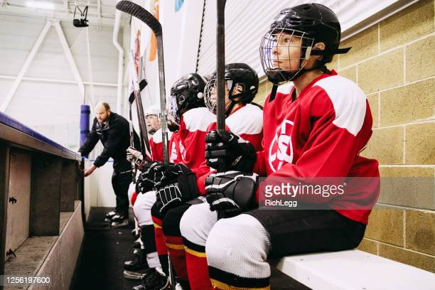 women ice hockey team on the bench - ice hockey player stock pictures, royalty-free photos & images