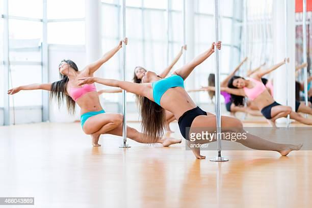 Women in a pole dance studio