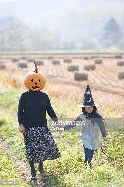 Women in a pumpkin mask with her granddaughter