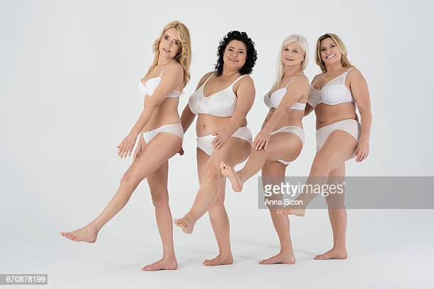 women in a row keeping legs up. debica, poland - chubby legs stock photos and pictures