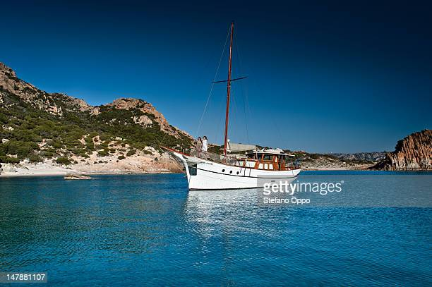 women in a sail boat - sardinia stock pictures, royalty-free photos & images