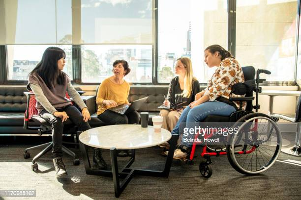 Women in an office environment working collaboratively - Repicturing Disability