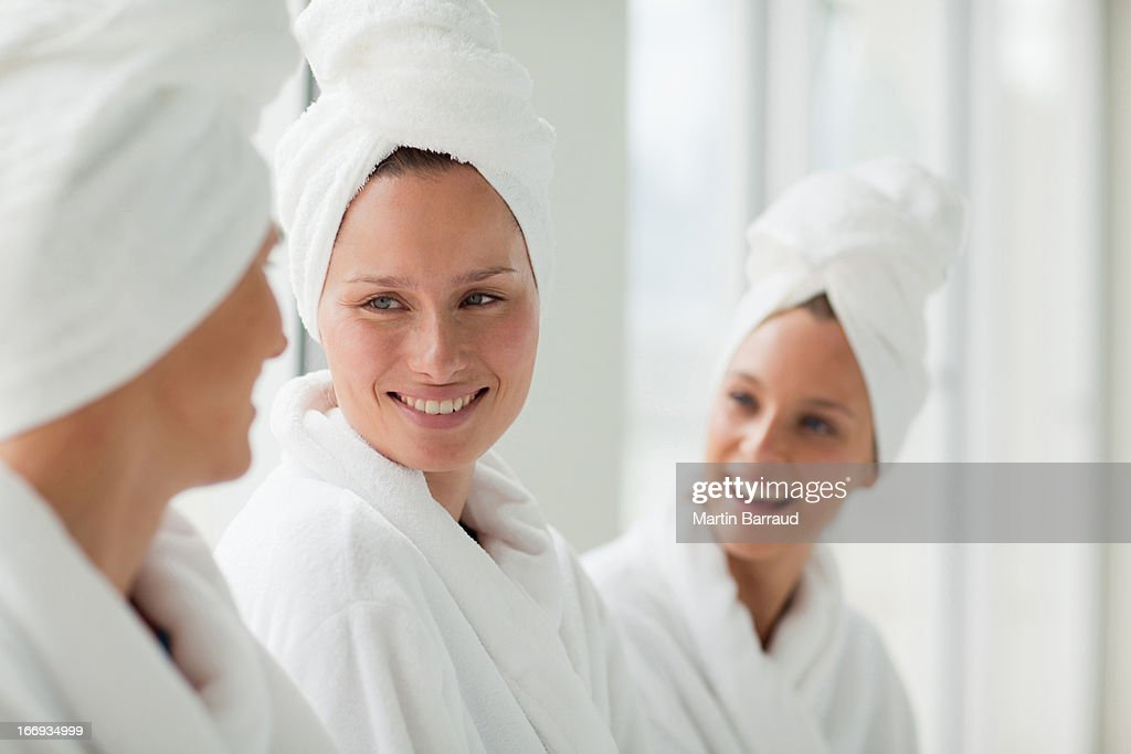 Women in bathrobes and hair wrapped in towels at spa : Stock Photo