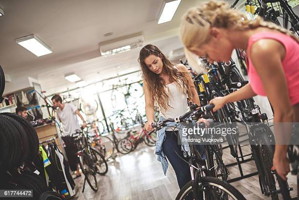 Women in bicycle store