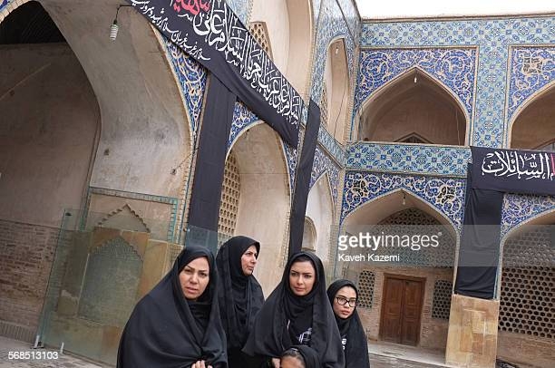 Women in black chadors look at the Jameh mosque on October 31st, 2014 in Isfahan, Iran.