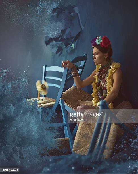 women in blue room with water splashes
