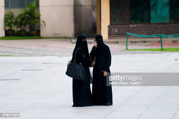Women In Burka Standing On Road