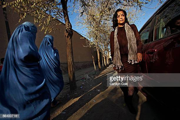 Women in burkas stare at Fereshta with her bare legs and uncovered head in Old Kabul's ShareKohna neighborhood Fereshta Kazemi visits the set of the...