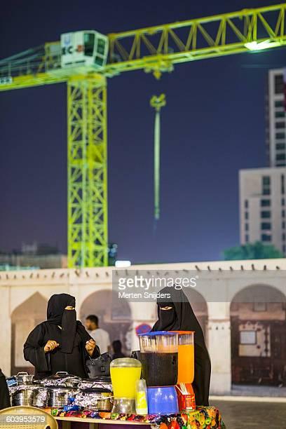 Women in burqa at food market